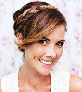 updo with side bangs and a crown braid